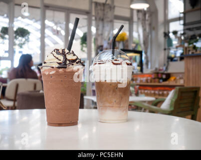 Latte frappe, chocolate frappe on white table at coffee shop. - Stock Photo