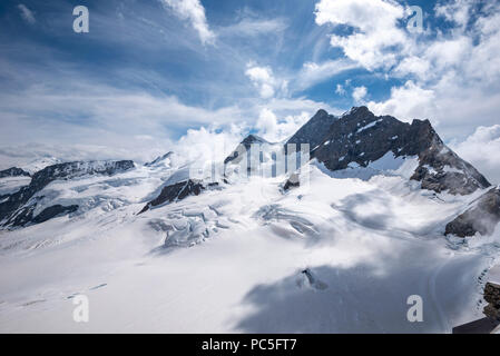 Jungfrau peak (4,158 m.) seen from Jungfraujoch, Grindelwald, Bernese Oberland, Switzerland - Stock Photo