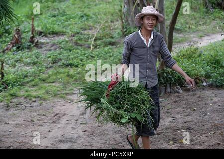 Bahnar (Ba Na) ethnic group. Farmer.  Kon Tum. Vietnam. | usage worldwide - Stock Photo