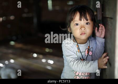 Bahnar (Ba Na) ethnic group.  Young girl. Portrait.  Kon Tum. Vietnam. | usage worldwide - Stock Photo