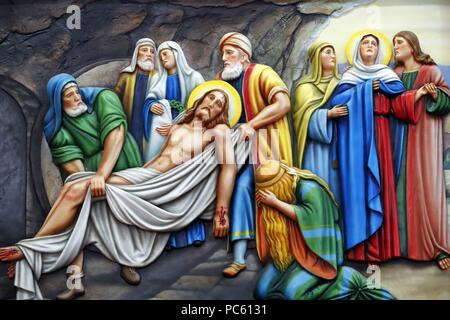 Our Lady of Fatima church.  Way of the cross.  Station 14. Jesus is placed in the tomb. Ho Chi Minh City.  Vietnam.   usage worldwide - Stock Photo