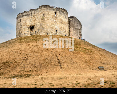 Parched grass on the banks at Cliffords Tower in the hot summer of 2018 City of York Yorkshire England - Stock Photo