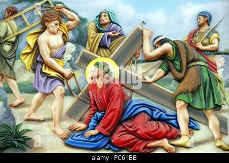 Our Lady of Fatima church.  Way of the cross.  Station 7. Jesus falls for the second time. Ho Chi Minh City.  Vietnam.   usage worldwide - Stock Photo