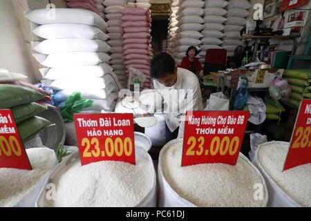 Price of white rice per kilogram in Vietnam Dong. Ho Chi Minh City. Vietnam. | usage worldwide - Stock Photo