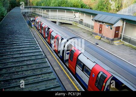 Northern Line train at High Barnet London Underground station - Stock Photo