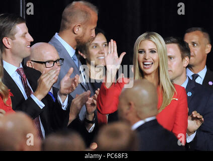 Tampa, Florida, USA. 31st July 2018. U.S. President Donald Trump's daughter, Ivanka Trump, waves as her father introduces her at a Make America Great Again Rally on July 31, 2018 at the Florida State Fairgrounds in Tampa, Florida. President Trump's son, Eric, is seen clapping at left.(Paul Hennessy/Alamy) Credit: Paul Hennessy/Alamy Live News - Stock Photo