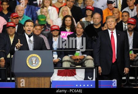 Tampa, Florida, USA. 31st July 2018. U.S. President Donald Trump listens to U.S. Rep. Ron DeSantis (R-FL) as he asks for the support of Trump voters in his bid to become Florida's next governor at a Make America Great Again Rally on July 31, 2018 at the Florida State Fairgrounds in Tampa, Florida. (Paul Hennessy/Alamy) Credit: Paul Hennessy/Alamy Live News - Stock Photo