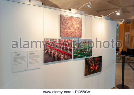 Edinburgh, UK. 1st August, 2018. Some of the exhibits on show at the launch of the World Press Photo Exhibition at the Scottish Parliament. The worldwide touring exhibition showcasing more than 100 of the most challenging and powerful examples of photojournalism taken in 2017, will be held in the Main Hall from the 1st - 25th August. Photo: Roger Gaisford/Alamy Live News - Stock Photo