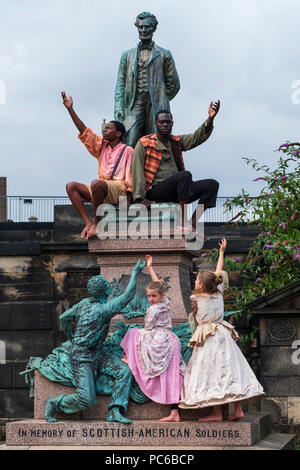 Edinburgh, Scotland, UK; 1 August, 2018. The cast of Henry Box Brown: a Musical Journey at the statue of President Lincoln in the Old Calton Burial Ground, Edinburgh. New York Gospel singers from a new Edinburgh Fringe musical about an American slave shipped to freedom in a 3ftX2ft box gather at American Civil War Memorial to honour the Scots who fought against slavery in the American Civil War. Credit: Iain Masterton/Alamy Live News - Stock Photo