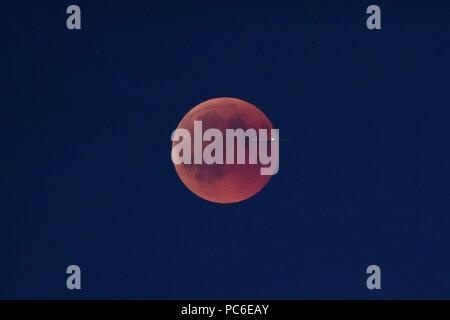 firo, Astronomie 1, 27.07.2018 celestial body, moon, blood moon, red, reddish moon, lunar eclipse, plane in front of the moon, | usage worldwide - Stock Photo