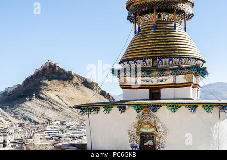 Gyantse Kumbum and Gyantse Dzong or fort in the background, Tibet - Stock Photo