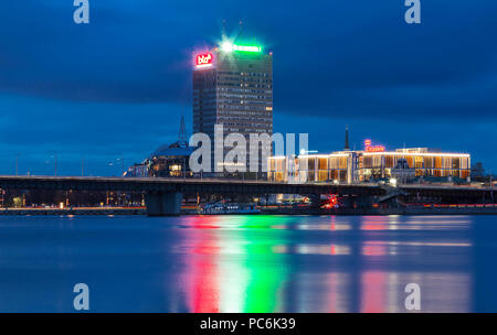 The night view of Riga modern buildings with scenic water reflections in Daugava river waters, Latvia. - Stock Photo