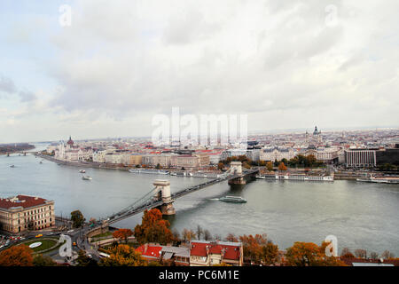 Budapest, Hungary - October 29, 2016: Landmark of Budapest, Chechen Chain Bridge that spans the River Danube between Bud and Pest. Buildings at the ba - Stock Photo
