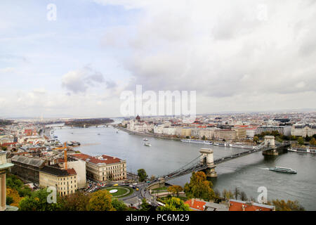 Budapest, Hungary - October 29, 2016: Landmark of Budapest, Szechuan Chain Bridge that spans the River Danube between Bud a and Pest. Buildings - Stock Photo