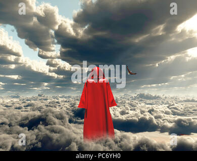 Figure in red cloak stands on a field of clouds. - Stock Photo