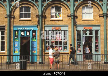 Shops inside Covent Garden Market London - Stock Photo