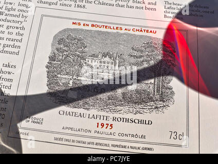 CHATEAU LAFITE-ROTHSCHILD Shadow of tasting glass on wine label premier Grand Cru Classé   Lafite-Rothschild 1975 red wine Pauillac Bordeaux France - Stock Photo