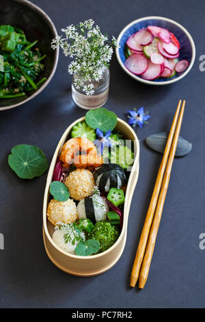 Bento box with onigiri, prawns and vegetables - Stock Photo