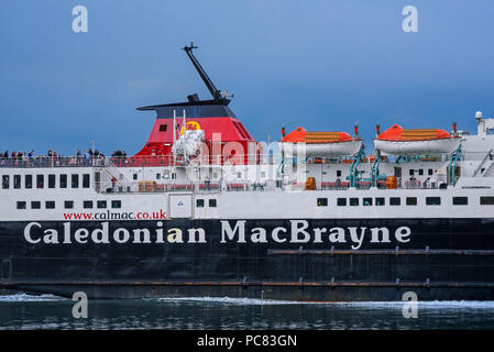 Passengers on deck of the Caledonian MacBrayne ferry boat Isle of Mull / An t-Eilean Muileach leaving the port of Oban - Stock Photo