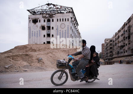 Dumanian family on the motorcycle in Duma-Damascus Syria in 20-5-2018. - Stock Photo