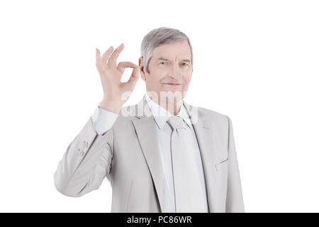 closeup.handsome senior businessman showing OK gesture. - Stock Photo