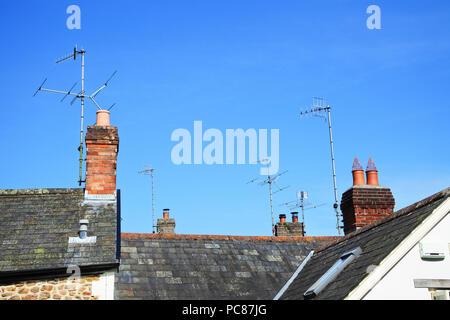 Multiple TV aerials on British rooftops - John Gollop - Stock Photo