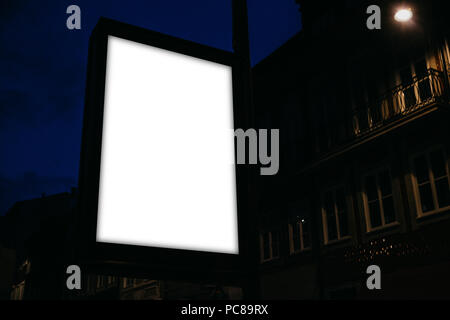 Modern empty billboard with space for text at night - Stock Photo