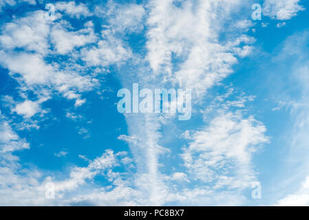 Beautiful blue sky with clouds and an air train from the plane. The texture of the sky. Background - Stock Photo