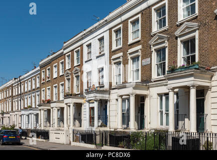 Terraced houses on Westbourne Park Road  in Notting Hill area, London, UK - Stock Photo