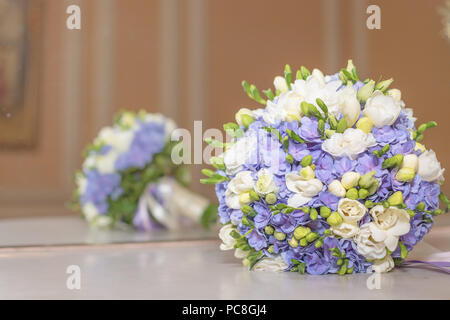Wedding bouquet flowers bridal bouquet. beautiful white blue bouquet isolated on marble table against mirrow.colorful flowers white and blue freesia and hydrangea. Copy space - Stock Photo