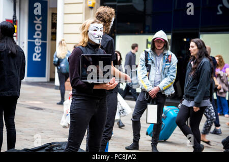 2nd June 2018 Manchester, UK - Anonymous wearing masks protesting animal cruelty in the food industry - Stock Photo