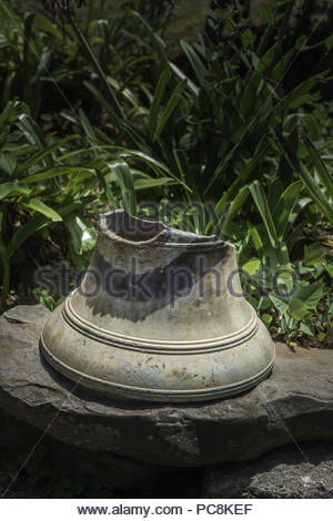 Cracked bell from the HMS Bounty, a British ship taken over by mutineers who later escaped to live on Pitcairn Island. - Stock Photo