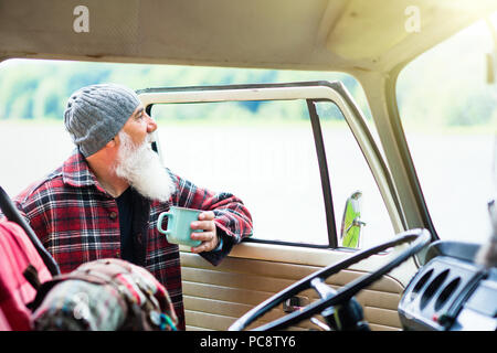 senior man near his pickup, ready for a hike in the woods - Stock Photo