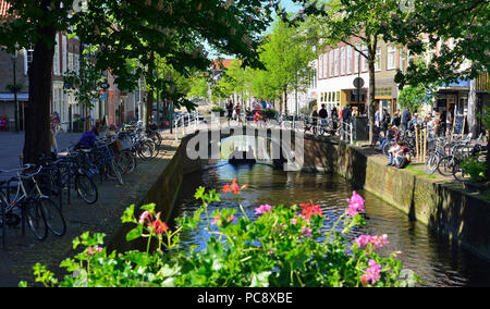 View of canal on a sunny spring day in the town centre of the stunning historic Dutch town of Delft, Holland, Netherlands - Stock Photo