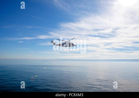 Gardacostas de Galicia Sikorsky S-76C EC-JET Helicopter flying low over the Mediterranean sea off the coast of Vigo, Spain - Stock Photo