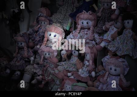 Spooky rag doll in a girl's bedroom - Stock Photo