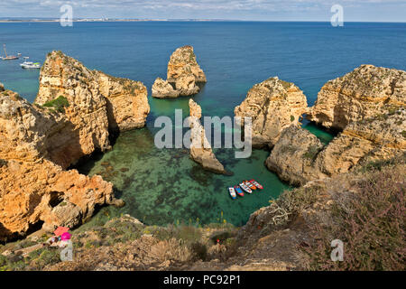 Popular rugged coast of the ponte de Piedade, in Lagos Portugal. Also part of the Algarve region. - Stock Photo