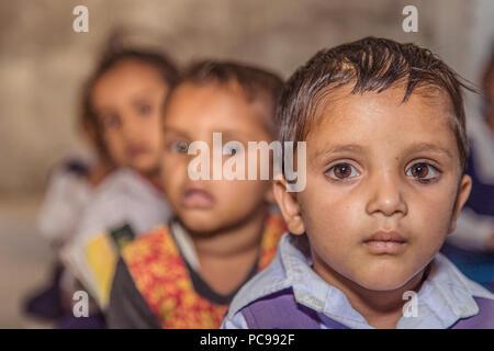 Portrait of Indian rural pre school girls in classroom at village school. - Stock Photo