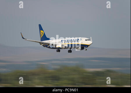 An Ryanair Boeing 737-8AS comes in to land at Manchester Airport, UK. - Stock Photo