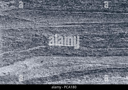 Migmatitic gneiss migmatite rock bands pattern, grey light dark banded granite texture macro closeup, large detailed textured silver gray horizontal