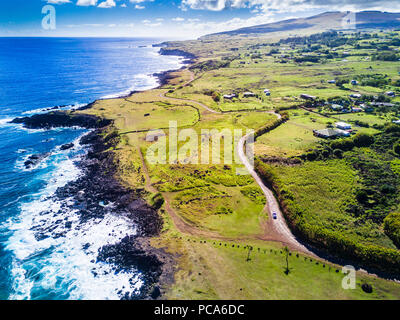 An aerial view to the north on the west coast of Easter Island at its town Hanga Roa viewing a wonderful coastline, Rapa Nui, Chile - Stock Photo