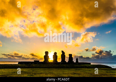 Ahu Tahai alone Moai at Hanga Roa, Easter Island. This is the only one with painted eyes like it was on the past. - Stock Photo