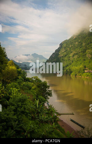 Misty mountains in Nong Khiaw, Laos PDR after the rain. - Stock Photo