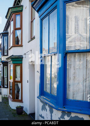 Colorful bay windows of a cottage in the small resort village of Criccieth on the Llyn peninsula, Gwynedd in Wales, UK. - Stock Photo