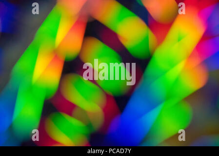 Beautiful cool background with a blurred spectrum of rainbow colors in the defocus - Stock Photo