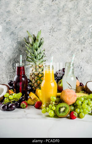 Different fruit juices smoothies concept, summer vitamins diet, with tropical fruits and berries on a light background, - Stock Photo