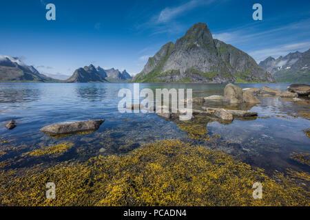 Mount Olstinden close to Reine, Lofoten Islands, Norway. - Stock Photo