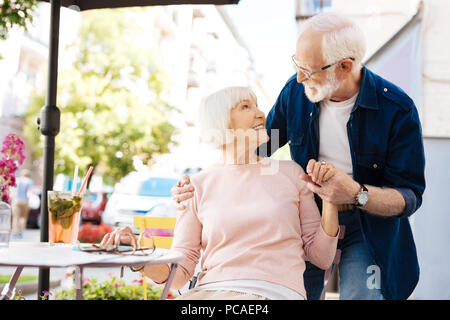 Attractive senior man and woman having date - Stock Photo