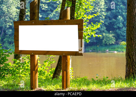 Blank information stand billboard mock up in the city park - Stock Photo
