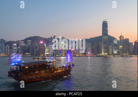 Junk boat in Victoria Harbour at dusk, Hong Kong Island, Hong Kong, China, Asia - Stock Photo